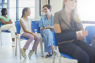 Nurse and patient talking in hospital - CAIF08529