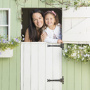 Portrait smiling mother and daughter in playhouse window - CAIF08904
