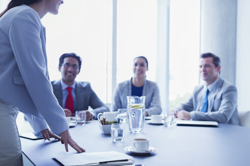 Businesswoman leading meeting in conference room - CAIF08988