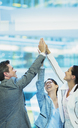 Enthusiastic business people with arms raised in office - CAIF08997