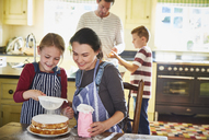 Family baking cake in kitchen - CAIF09204