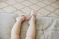Legs of toddler girl wearing ballet shoes - CAIF09219