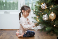 Toddler girl decorating Christmas tree - CAIF09222