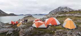 Greenland, Sermersooq, Kulusuk, Schweizerland Alps, group of people at camp - ALRF00925