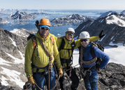 Greenland, Sermersooq, Kulusuk, Schweizerland Alps, portrait of happy mountaineers on summit - ALRF00931