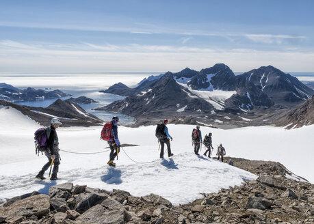 Greenland, Sermersooq, Kulusuk, Schweizerland Alps, group of people walking in snow - ALRF00934