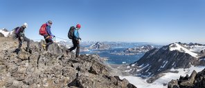 Greenland, Sermersooq, Kulusuk, Schweizerland Alps, mountaineers walking in rocky mountainscape - ALRF00952