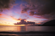 Scenic view of sea against cloudy sky during sunset - CAVF04288