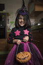 Portrait of little girl dressed up as a witch at Halloween - JASF01853