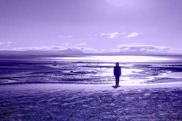 United Kingdom, Scotland, Solway Firth, silhouette of female tourist standing at beach - SMAF00979