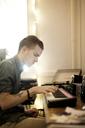 Man practicing piano at home - CAVF04498