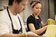 Chefs preparing pasta at commercial kitchen - CAVF04531