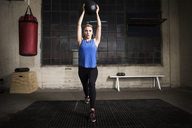 Woman exercising with medicine ball in gym - CAVF04810