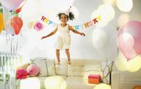 Playful girl jumping on sofa - CAIF09544