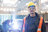 Portrait confident steel worker in factory - CAIF09772