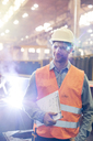 Steel worker with clipboard in factory - CAIF09787