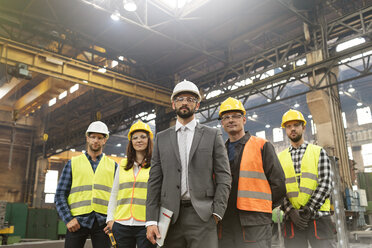 Portrait confident manager and steel worker team in factory - CAIF09814
