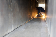 Welder using welding torch in steel tunnel - CAIF09844