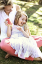 Cheerful family enjoying in backyard - CAVF05022