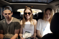 Friends sitting in car - CAVF05142