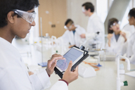 Male college student using digital tablet in science laboratory classroom - CAIF10008