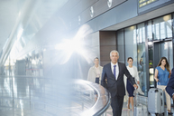 Business people walking in airport concourse - CAIF10020