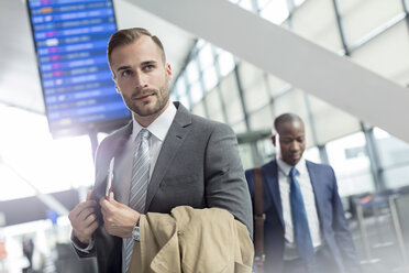 Businessman in airport concourse - CAIF10035