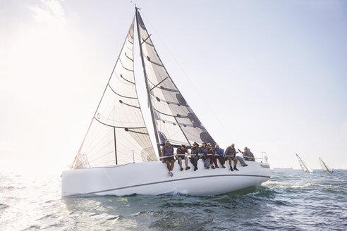 Friends sailing on sunny ocean - CAIF10158
