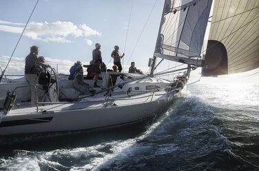 Friends sailing on sunny ocean - CAIF10170