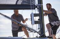 Men adjusting sailing equipment - CAIF10173