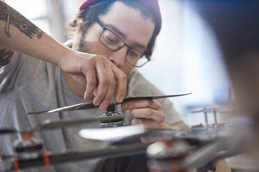 Male designer assembling drone - CAIF10644