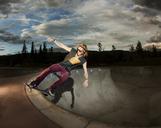 Man skateboarding in skateboard park - CAVF05488