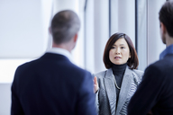 Businesswoman talking to colleagues - CAIF10671