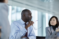 Businessman talking in meeting - CAIF10680