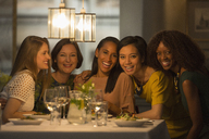 Portrait smiling women friends dining at restaurant table - CAIF10776
