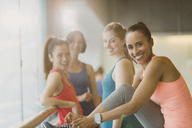 Portrait smiling women in gym studio - CAIF10779