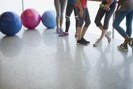 Legs of women and fitness balls in exercise class gym studio - CAIF10941