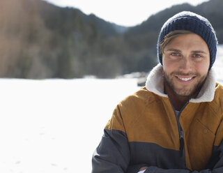 Portrait of smiling man in snow - CAIF11028