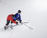 Hockey players going for puck on ice - CAIF11157