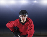 Portrait confident hockey player in red uniform - CAIF11169