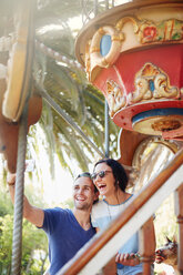 Young couple taking selfie at amusement park - CAIF11313