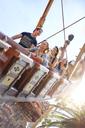 Friends riding amusement park ride - CAIF11328