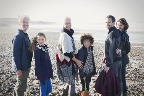 Portrait smiling multi-generation family on sunny beach - CAIF11493