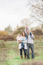Portrait smiling family in autumn park - CAIF11550