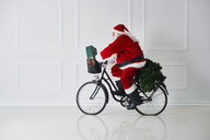Santa Claus riding bicycle - ABIF00104