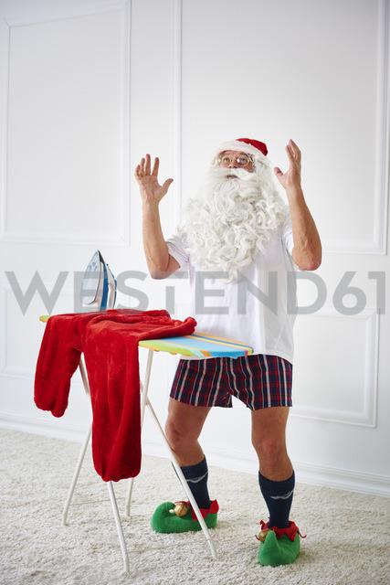 Santa claus with iron board and flat iron - ABIF00116