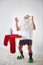 Santa claus with iron board and flat iron - ABIF00116