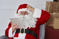 Portrait of Santa claus using tablet - ABIF00119
