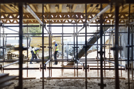Construction workers working at construction site - CAIF11594