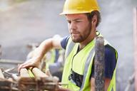 Construction worker lifting rebar - CAIF11627